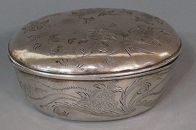 A Continental 18th Century silver coloured metal oval box and cover, the li