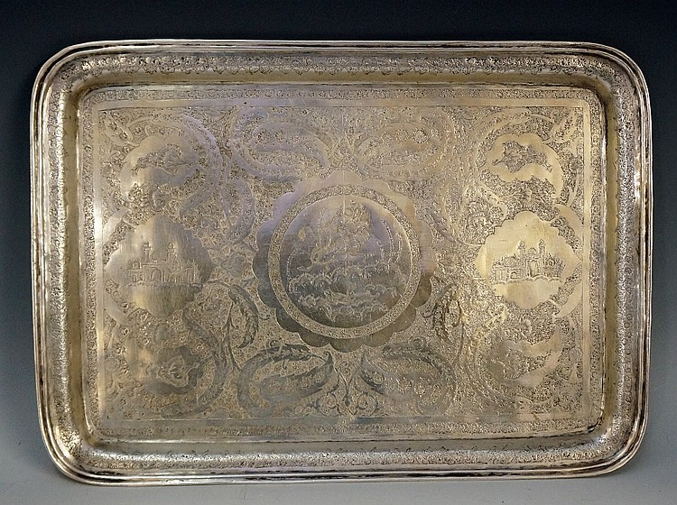 A good Iranian silver coloured metal tray, the rectangular body profusely e
