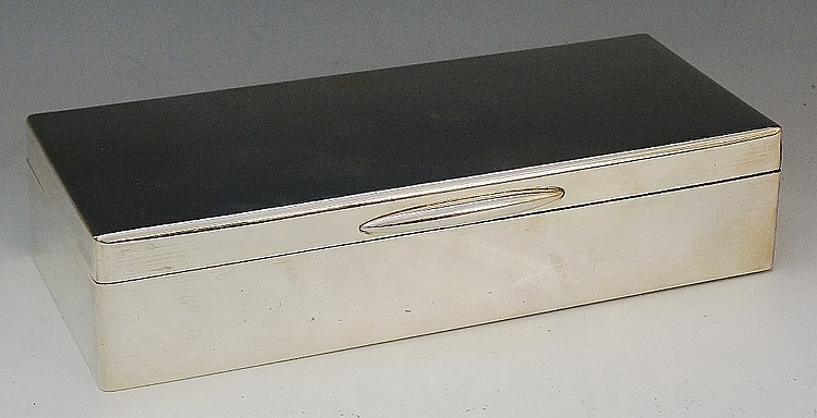 A silver Garrard & Co cigarette box, plain body, wooden interior with three
