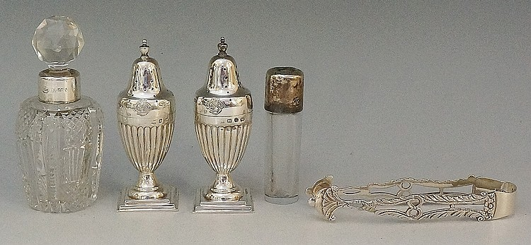A selection of silver items to include: a pair of pepperettes, half lobed b