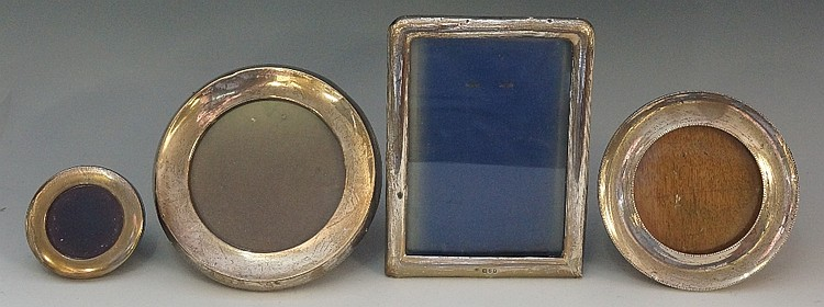 A selection of silver fronted photo frames to include: a plain rectangular