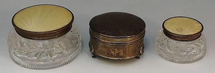 A silver dressing table box with plain circular body and engine turned lid,