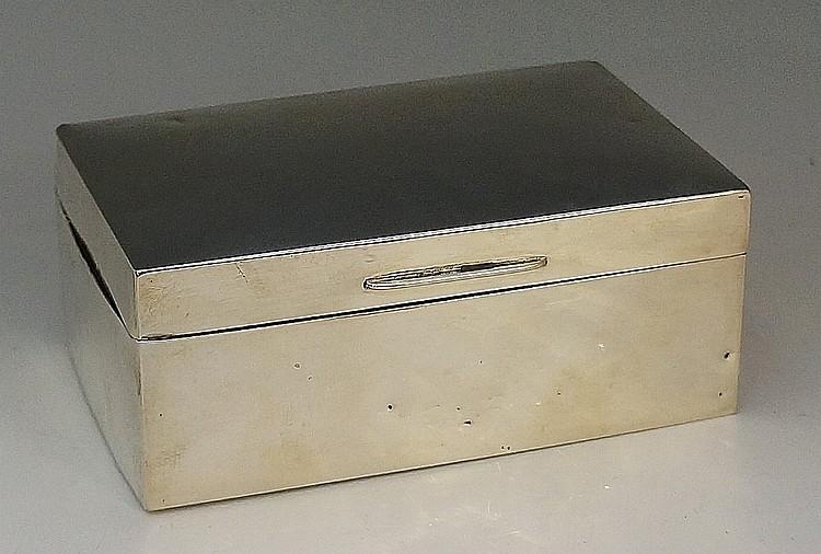 A silver cigarette box, plain body, wooden interior with two adjustable com