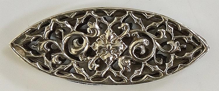 An unusual silver vinaigrette?, pierced scrolling foliate sides surrounding