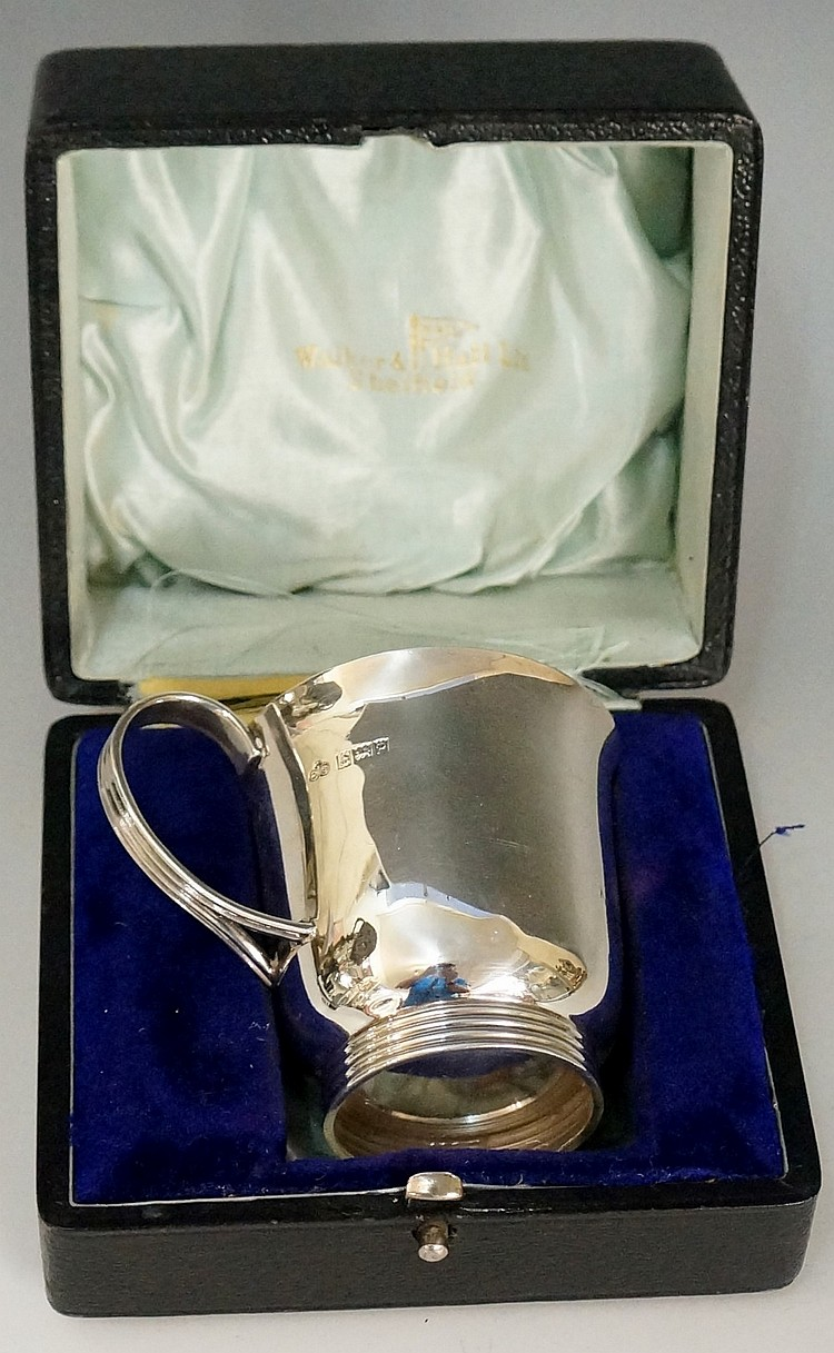 A silver Christening mug, plain body with reeded handle and foot, slightly
