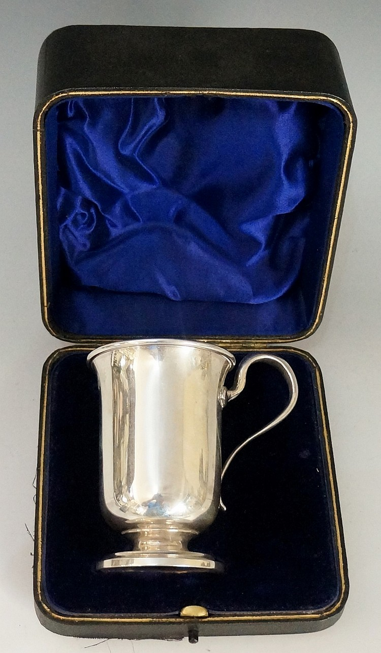 An Edwardian silver Christening mug, plain body with folded over rim, stepp