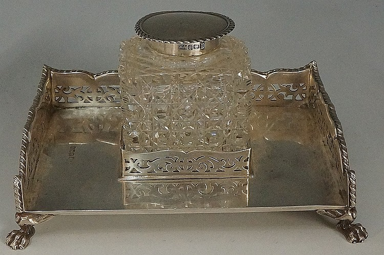 A silver inkstand, the base with shaped pierced sides and applied rope twis