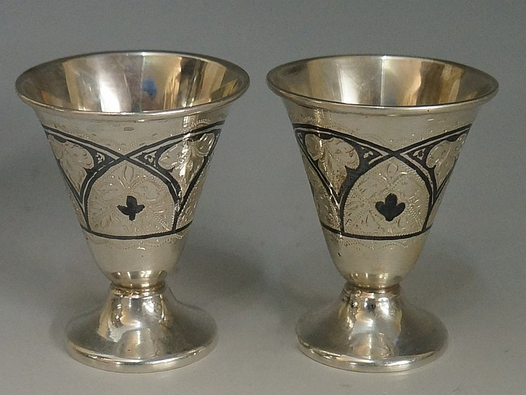 A pair of small Russian niello silver goblets, the trumpet form bodies engr