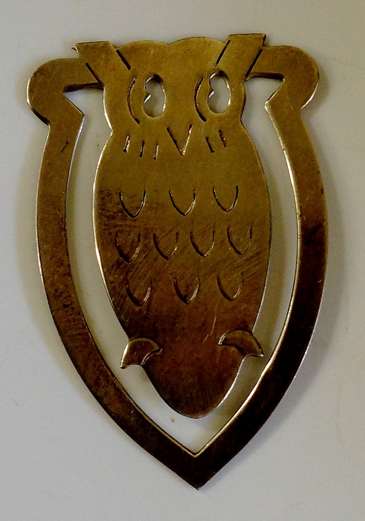 A silver bookmark in the form of an owl, by Harrison Brothers & Howson Ltd,