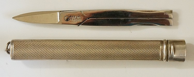 A small scissors case with engine turned sides, possibly for a chatelaine,