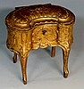 A late 19th Century French gilt metal jewel box of kidney shape, the hinged