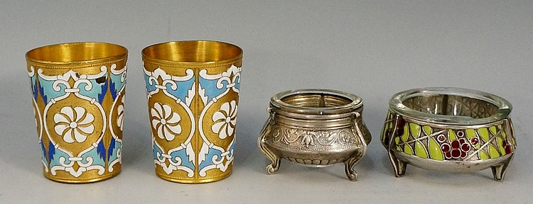 A selection of items to include: a pair of gilded brass beakers with blue a