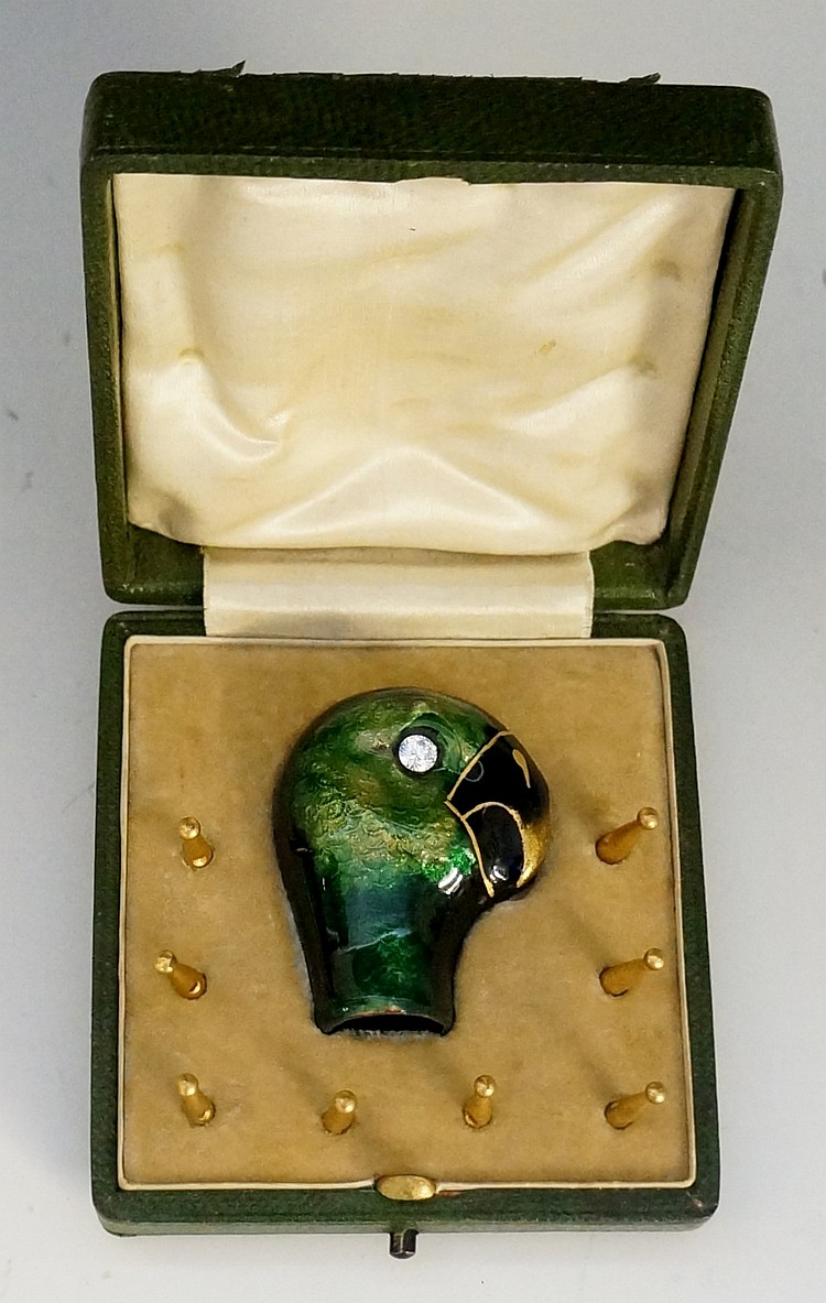 A fine enamel parasol handle terminal finely modelled as a parrot's head wi