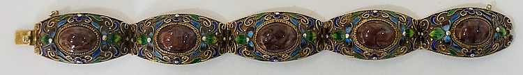 A gilt metal articulated bracelet, the five shaped links with stone cabocho