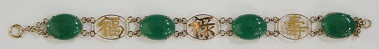 A Chinese yellow gold and jadeite bracelet, alternately set with oval green