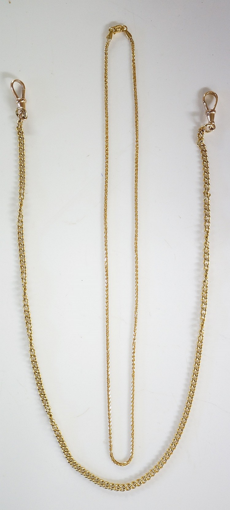 A 9ct gold curb link chain, 46cm long, 18gms; an Italian 18ct yellow gold c