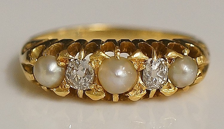 A ladies yellow gold diamond and pearl ring, the pierced shoulder set with
