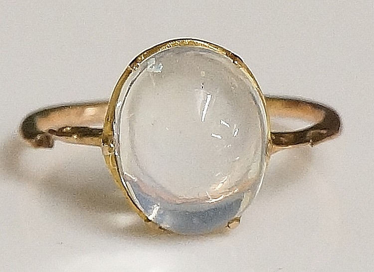A ladies gold moonstone set ring the pierced collet claw set with an oval s