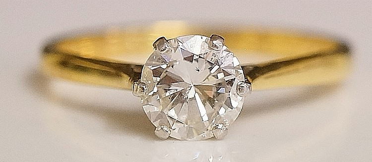 A ladies 18ct yellow gold solitaire diamond ring the claw set old cut brill