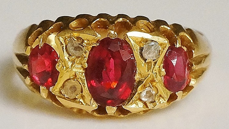 A ladies 18ct yellow gold ruby and diamond ring, the tablet pavé set with o