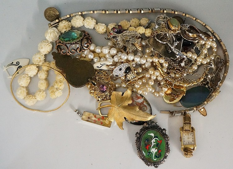 A bag of costume jewelry including ivory necklace, cultured pearls, bracele