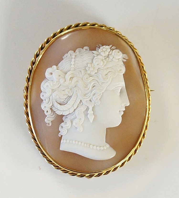 A good Victorian shell cameo, the oval finely carved with a female's head h