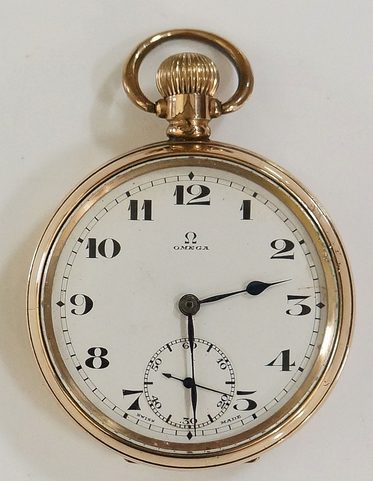 An Omega gold plated pocket watch, top wind, the white enamel face with sub