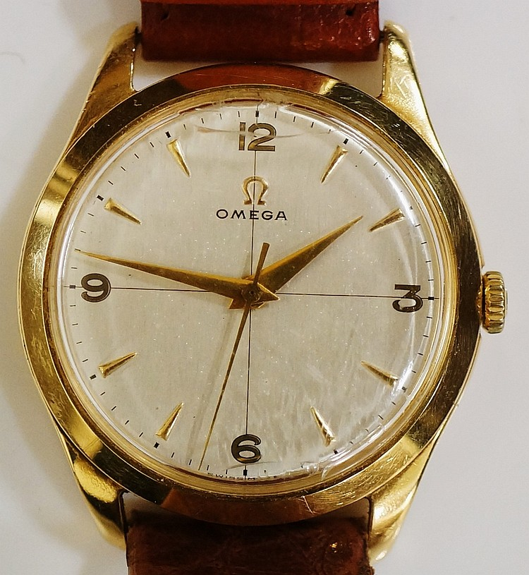 An 18ct yellow gold Omega gentleman's wristwatch, the champagne dial inscri