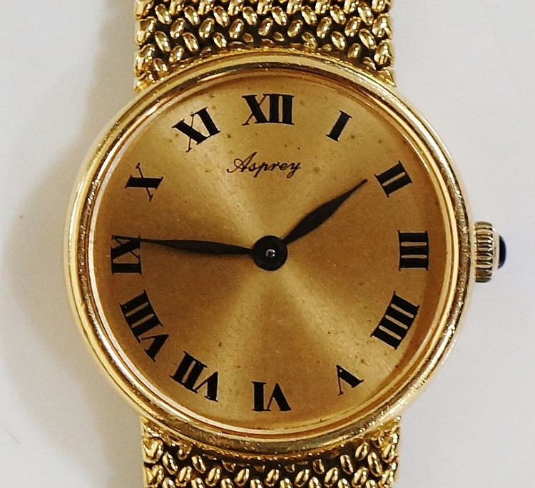 A ladies 18ct yellow gold wristwatch, the circular dial with gold face insc