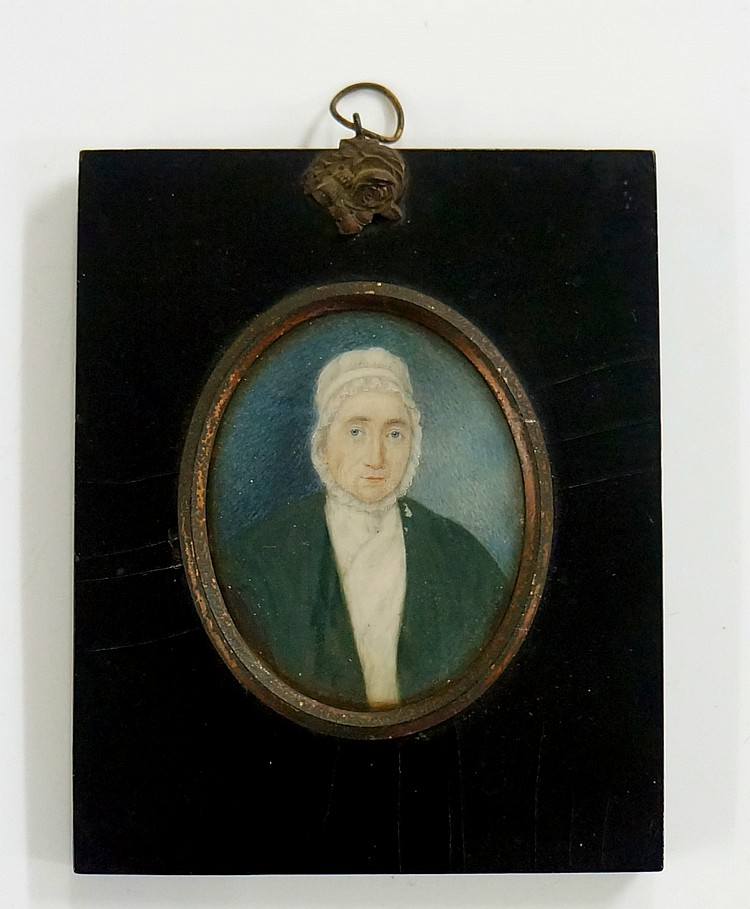 A 19th Century oval portrait miniature, head and shoulders of an elderly wo