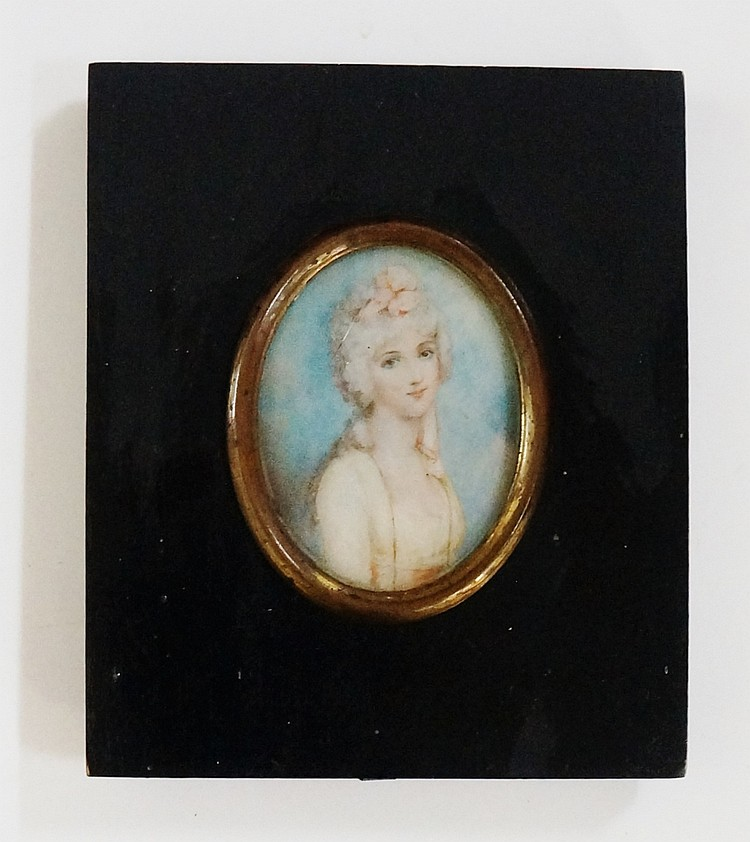 A 19th Century oval portrait miniature, head and shoulders of a young woman