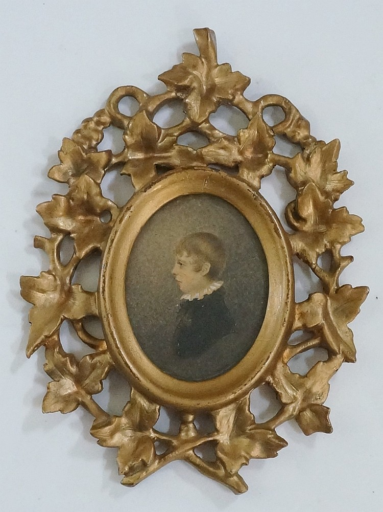 A 19th Century oval  portrait miniature of a young boy in profile, head and