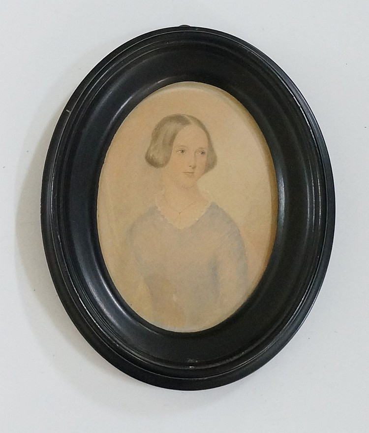 A 19th Century oval half length portrait miniature of a young girl wearing