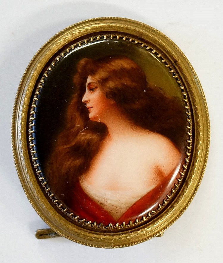 A continental porcelain oval portrait plaque of a young woman, head and sho