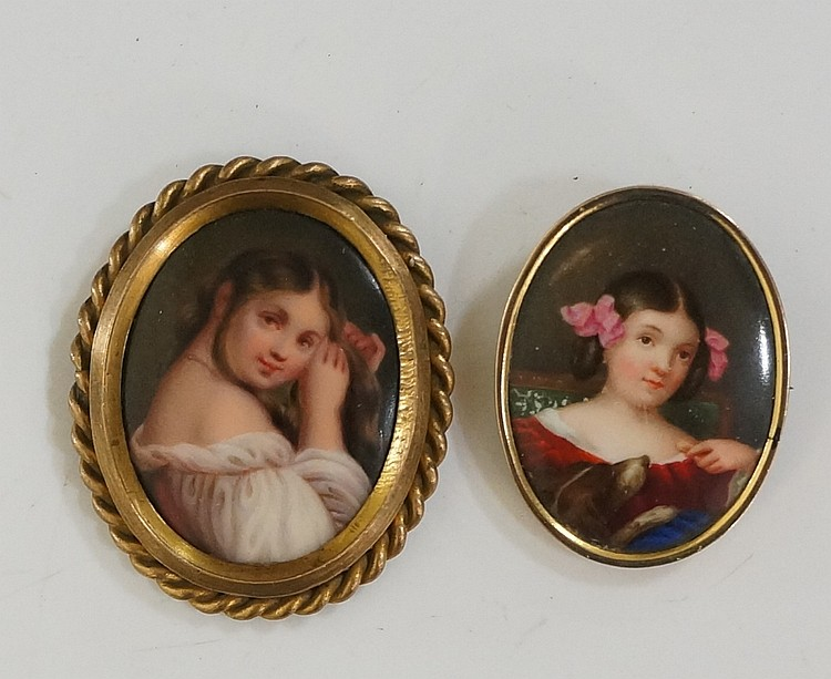 Two oval porcelain portrait miniatures, both with young girls, one with dog