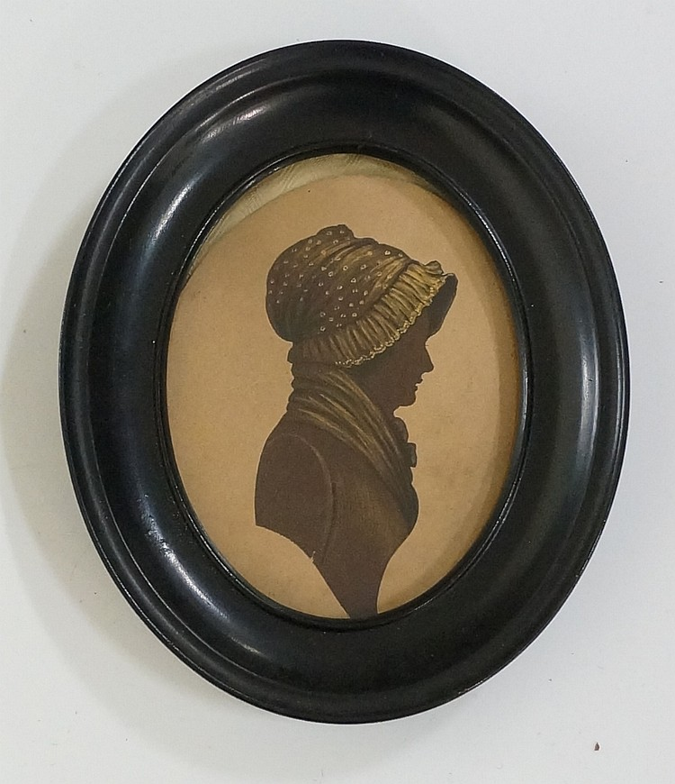 A pair of early 19th Century oval silhouette head and shoulder portrait min