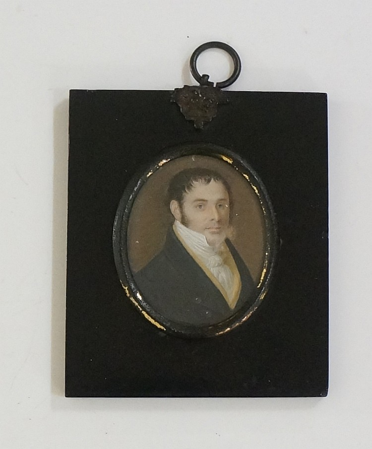 An early 19th Century oval portrait miniature of a gentleman wearing black