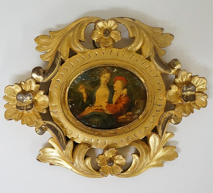 A fine quality oval miniature picture depicting an amorous couple both smok