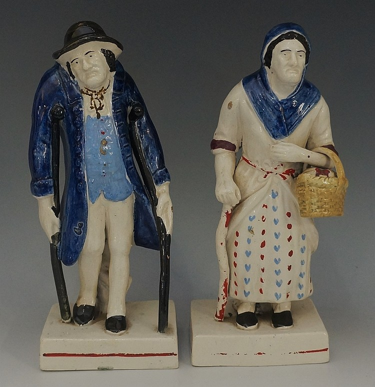 A pair of Staffordshire polychrome decorated pottery figures, one an invali