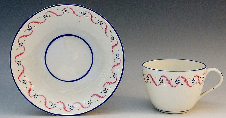 Pinxton - a pattern number 22 cup and saucer decorated with red foliate tra