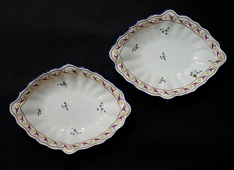 Pinxton - a pair of diamond shaped dishes, the centres with blue and green
