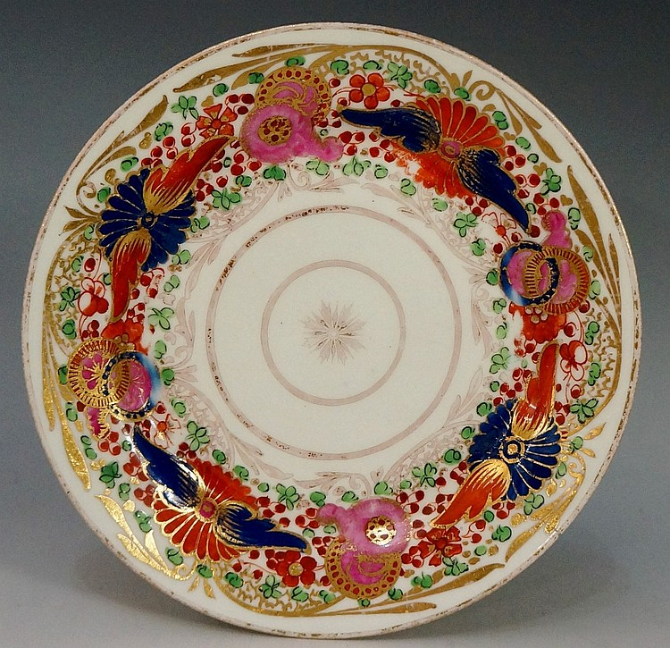 Pinxton - a pattern number 343 tea plate, the Imari pattern with gilt line