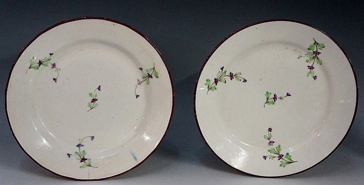 Pinxton - two pattern number 13 circular plates decorated with floral sprig