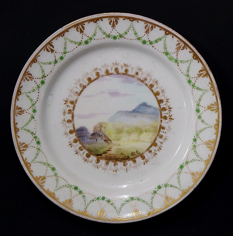Pinxton - a rare circular tea plate painted to the centre with a mountainou