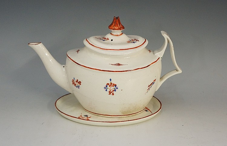Pinxton - A pattern number 1 boat shaped teapot cover and stand, decorated