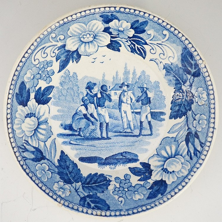 Slavery - a circular blue and white dish transfer printed to the centre wit