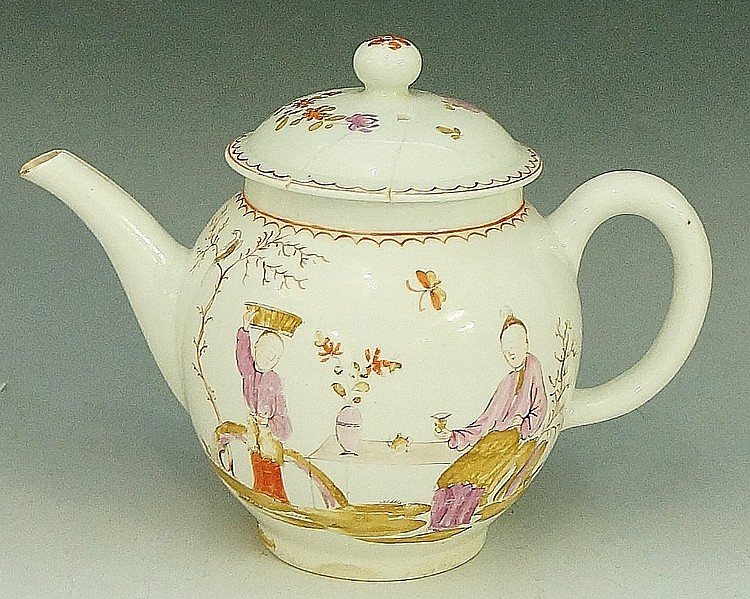 A Lowestoft porcelain bullet shaped teapot and cover decorated overall with