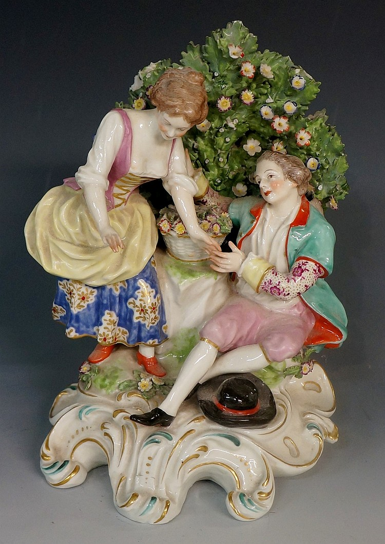 A Chelsea gold anchor period porcelain figure group of a young courting cou