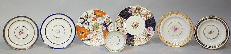 A Derby Prince of Wales pattern plate, the fluted border with apricot gilt