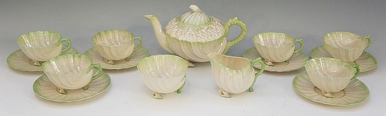 A Belleek Neptune pattern tea service, green tinted, comprising teapot, cre
